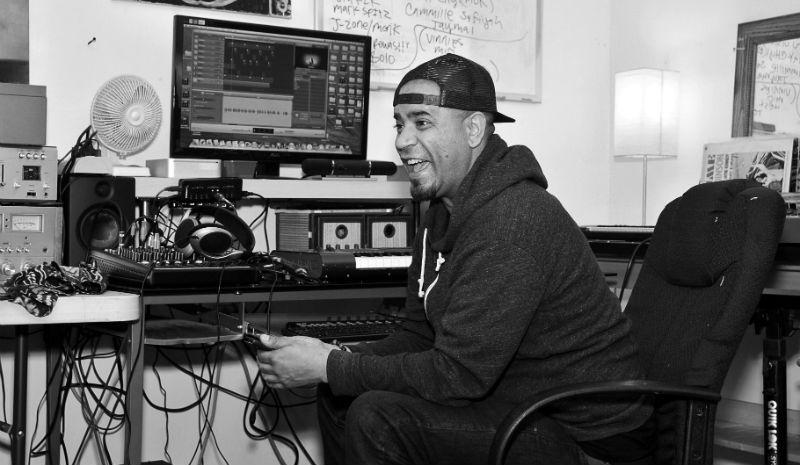 Music producer, Tahaj Edwards, in his East Oakland studio