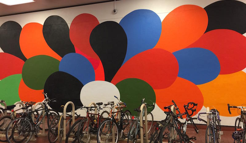 In the MacArthur station, this Mark Adams painted wall mural has become a backdrop for bikes, bike racks, and texting commuters awaiting their trains.