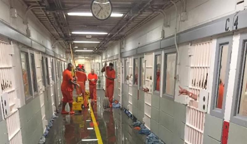 San Francisco inmates cleaning a sewage flood inside the Hall of Justice jail