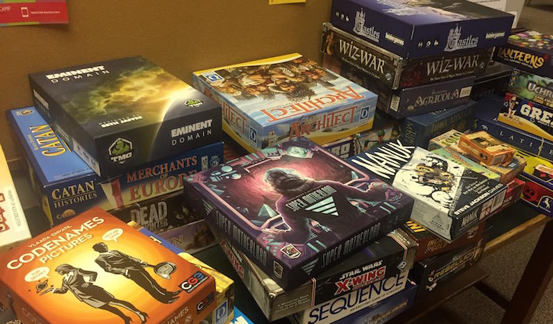 A stack of games sit at the corner of the room in Dolores Park Church.