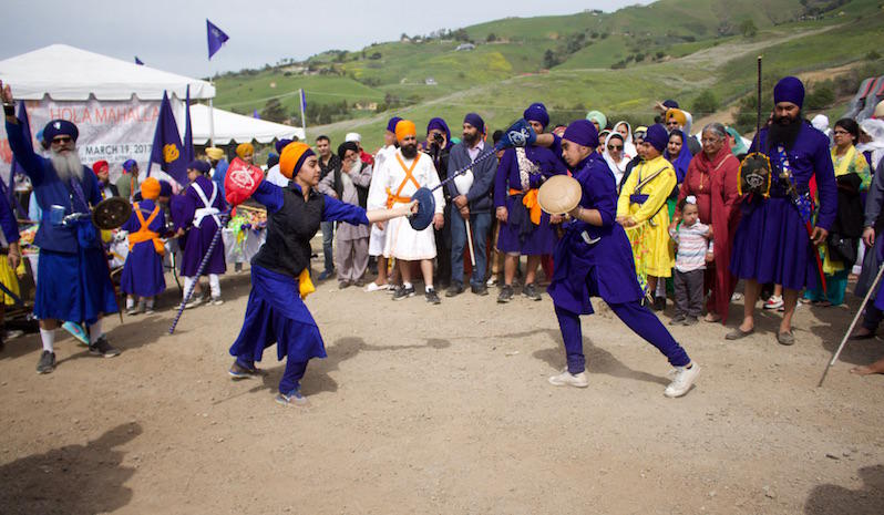 Pooja Kaur, on the left, practices the Sikh martial art called Gatka at the San Jose Sikh Temple