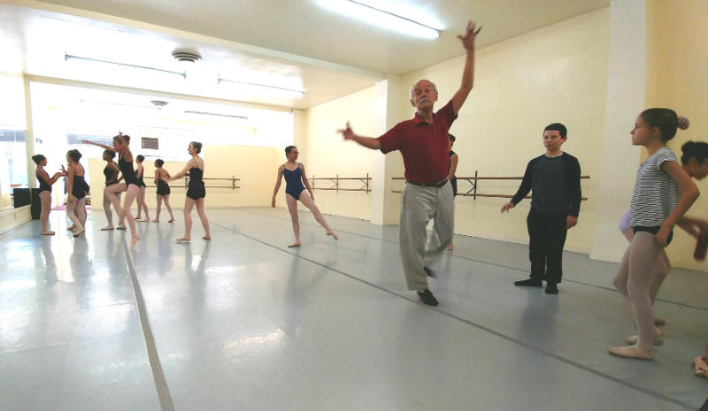 Choreographer, Carlos Carvajal, demonstrates moves for his ballet class