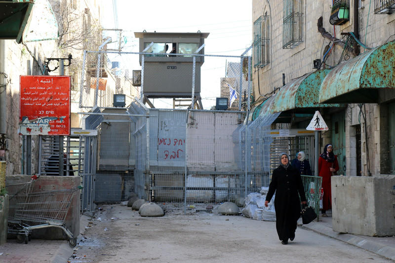 One of the 122 Israeli checkpoints and barriers installed in Hebron, this one blocking off Shuhada Street in February 2015.  Shuhada Street used to be the main road connecting East and West Hebron before it came under Israeli control