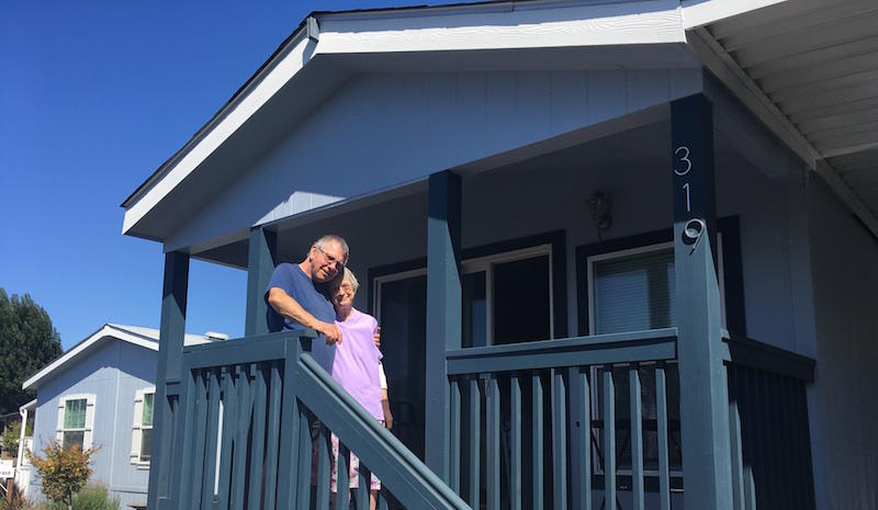 Barbara and Howard Hornsby stand in front of their new mobile home. Their old one was damaged in the 2014 earthquake.
