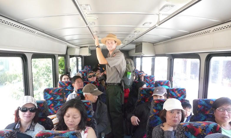 National Park Ranger Joseph Gibson takes library patrons on free shuttles to Land's End Park