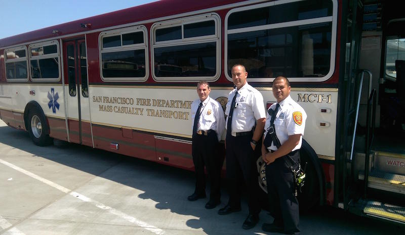 One of San Francisco's mass casualty ambulances, capable of carrying up to 22 patients. (From left: Chief Andy Zanoff, Lieut. Jonathan Baxter, and Capt. Clem Avila.)