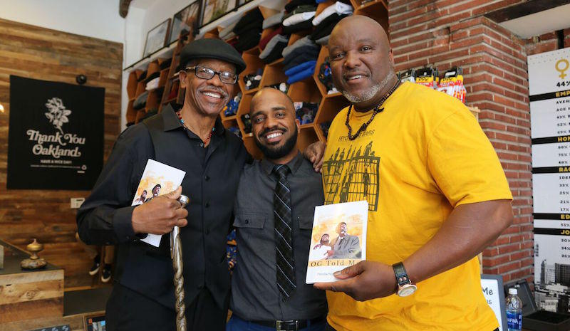 Author Pendarvis Harshaw with Watani Stiner and Troy Williams