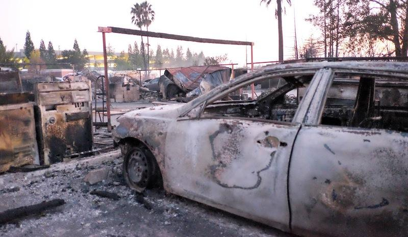 A burnt out car at the Journey's End Mobile Home Park in Santa Rosa