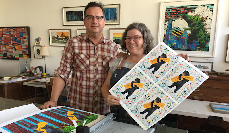 "Eric Rewitzer, Annie Galvin, and some of the ""I Love You California"" prints they made to raise money for North Bay fire victims"