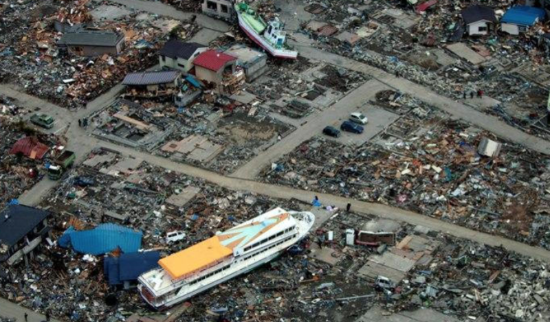 Two large boats sit in a destroyed neighborhood in Aichi, Japan after the 9.0 earthquake and subsequent tsunami on March 11, 2011.