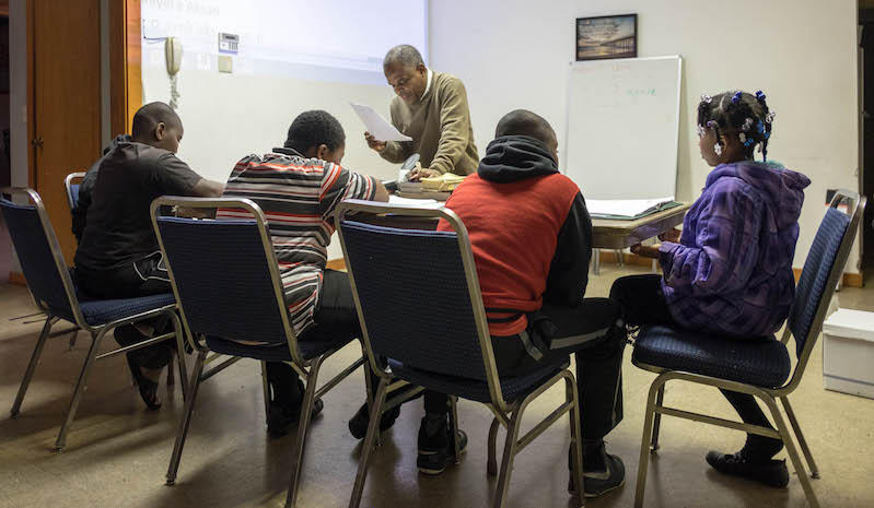 Pastor Fritz Toussaint teaches Haitian Creole to students