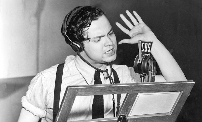 "1938 promotional photo of Orson Welles directing ""The Mercury Theatre on the Air."""