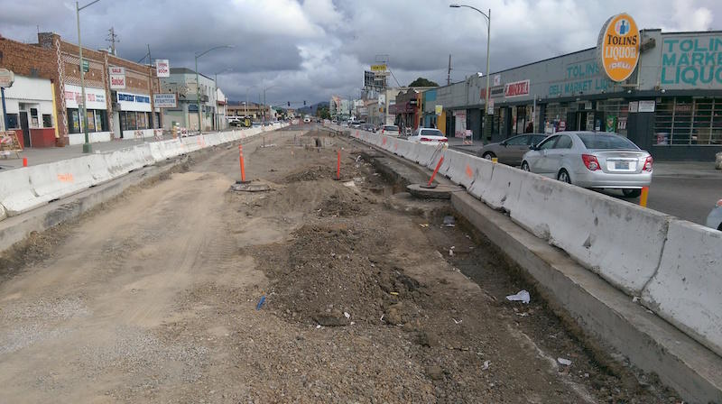 Traffic backs up on International Boulevard and 71st Avenue, where rapid-transit bus construction reduces traffic to two lanes. When the project is complete, many sections of the street will still have only two lanes for cars.