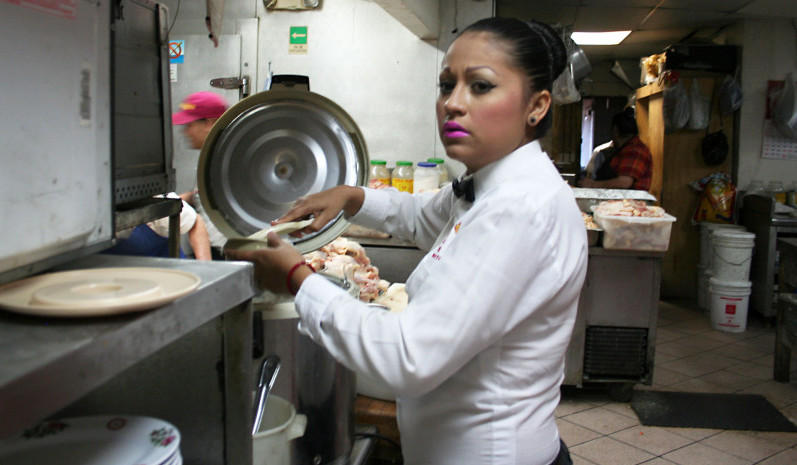 A waitress in the back of the house at El Dragon restaurant in Mexicali