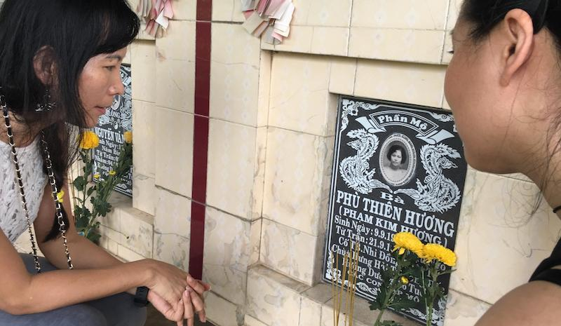 Kristie Nguyen and Thanh Tan visit Kristie's mother's grave in Vietnam.