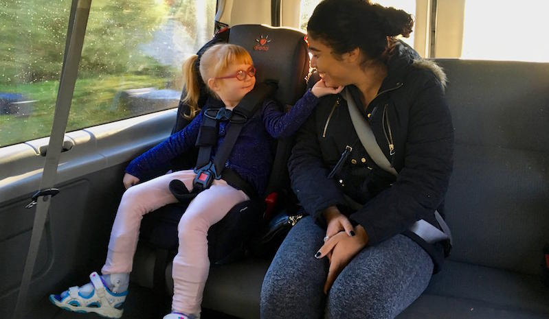 Brooke Adams, 4, cradles the face of Yolanda Brindis, her nurse, on the way to private preschool in Santa Rosa. The Rincon Valley Union School District covers the cost of the private placement, transports her there and provides Brooke's nurse.