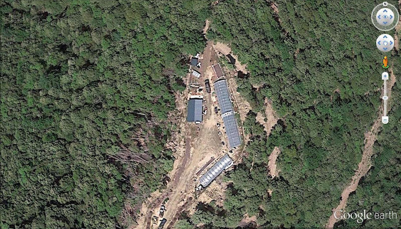 A Google Earth image of an opening in a forest in Humboldt County, and the growth of a cannabis farm inside the opening