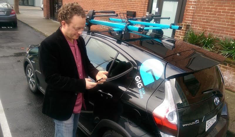 Jason Haight, president of Gig Car Share, with one of the company's new vehicles at their headquarters in Oakland