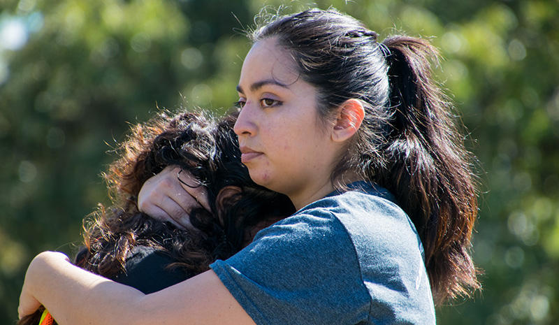 At a march to defend DACA in Raleigh, N.C. in October 2017, a woman spoke about her family members who are facing deportation if DACA is not extended or replaced. Another marcher comforts her.