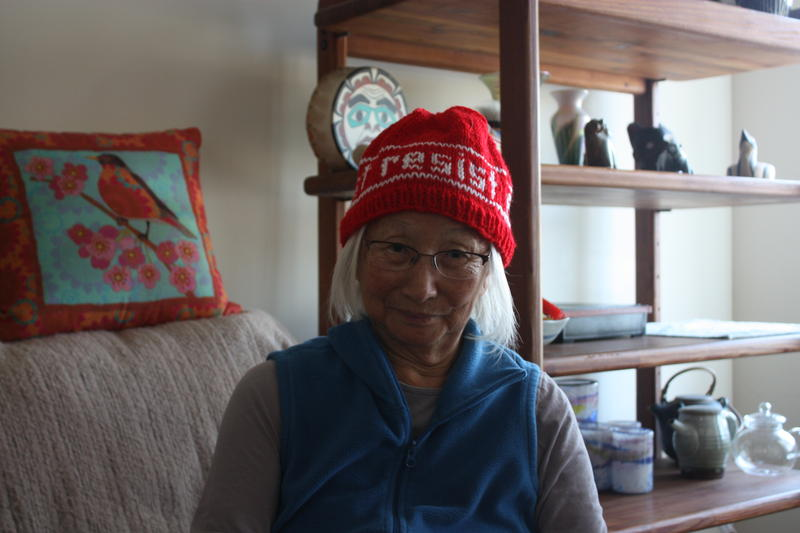 "Chizu Omori shows off her ""resist"" beanie in her Oakland home"