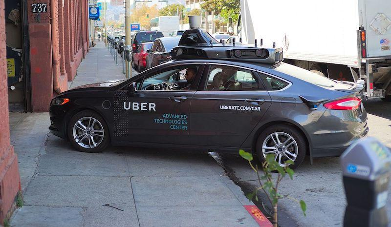 Uber tests an autonomous vehicle in San Francisco in 2016. Experts predict that driverless cars will increase demand for curbside loading zones