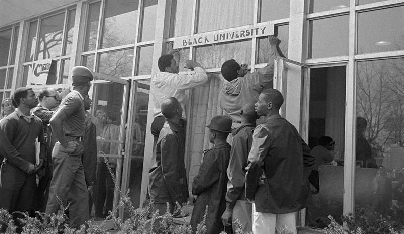 "Howard University students hang ""Black University"" sign on administration building"