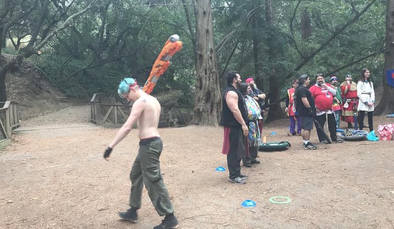 LARPers playing a game of Fight Elephant, a holiday party game that allows players to fight for presents. Friedan Gresh, aka Fidget Fagitolli, carries a foam weapon