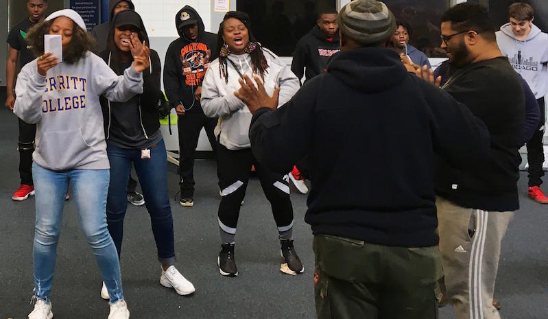 Oakland performer Thamsanqa Hlatywayo teaches teens some dance moves in preparation for their trip to South Africa. The students are taking part in Culture Keepers, a South African cultural-exchange program founded by Oakland educator Kharyshi Wiginton.