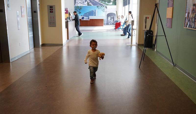 Antonio Godinez runs through the halls of Highland Hospital before getting a blood lead test.