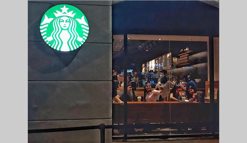 Selfie taking at Starbucks