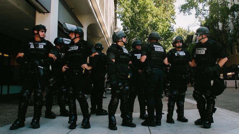 Sacramento police before a rally in Sacramento