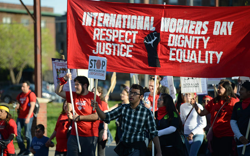 Hundreds march through downtown Minneapolis to mark International Workers Day in April 2016
