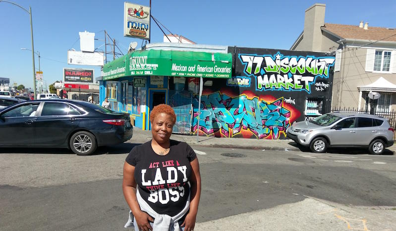 Shaniesa Williams stands at the intersection of International Blvd and 77th, where her son Jeremiah was hit.