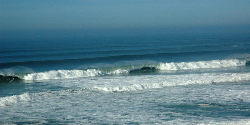 Offshore wind on waves, blue rolls in from a long distance away, Pomponio State Beach, Pescadero, California, USA