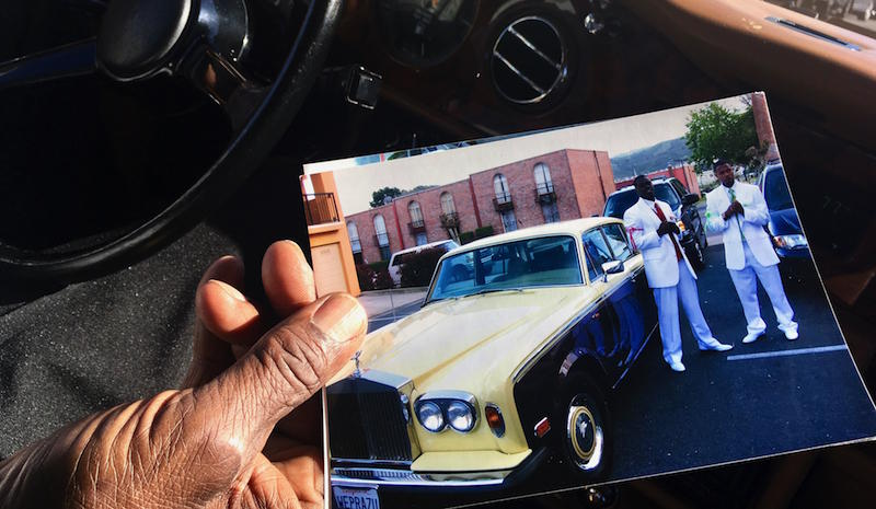 Walter Turner shows off a photo of his first Rolls Royce, which he bought to ferry youth from his Bayview Hunters Point neighborhood to prom. His current model is a 1989 Silver Spur
