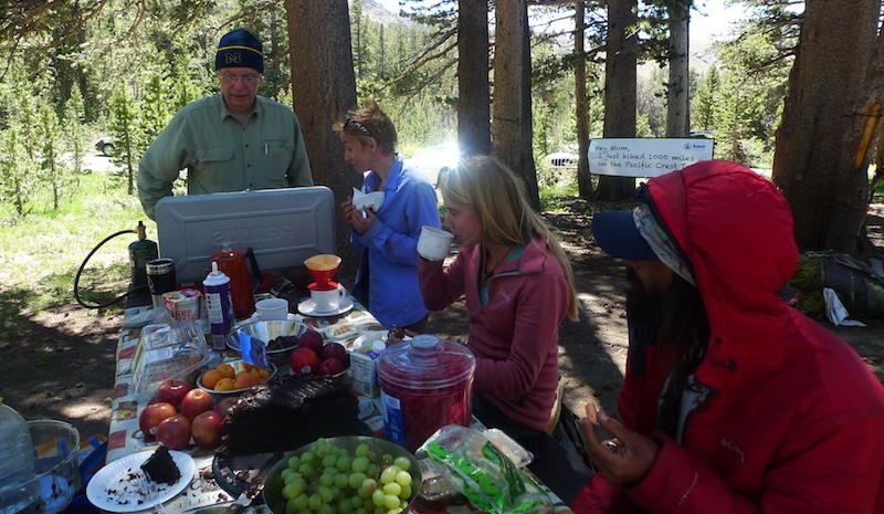 Hank Magnuski feeds hikers, including some who took advantage of his wifi with their smartphones.
