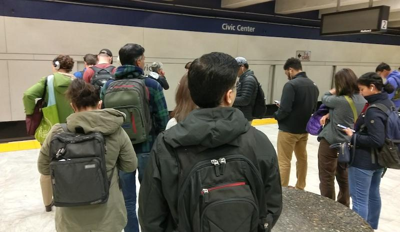 Passengers wait for a train at the Civic Center BART station in San Francisco.
