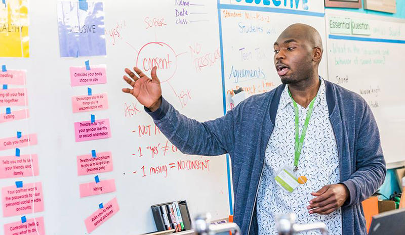 Health Connected Health Educator Nickolas Sumpter teaches an eighth grade class on healthy relationships.