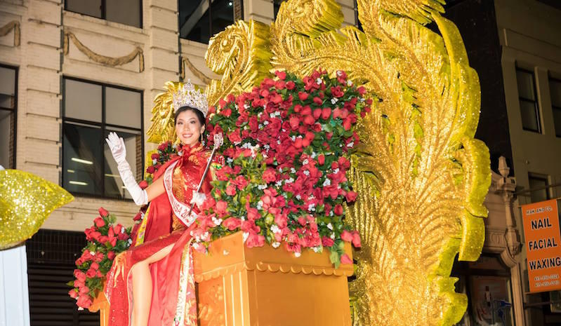 2018's Miss Chinatown USA Jasmine Lee waves to the crowd at the Chinese New Year Parade.