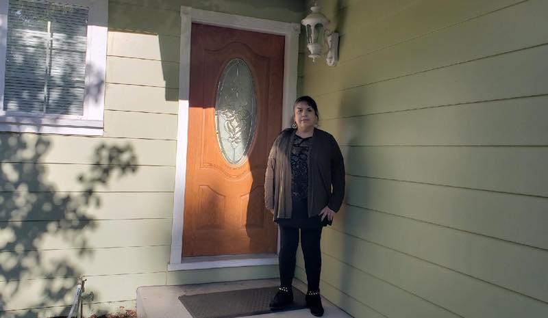 Maria Rodriguez in front of her new home in Pinole where she lives with her daughter.