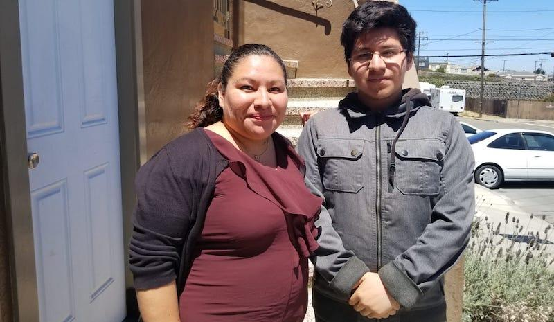 Christopher and his mother, Elizabeth Olvera, in front of their home in San Francisco.