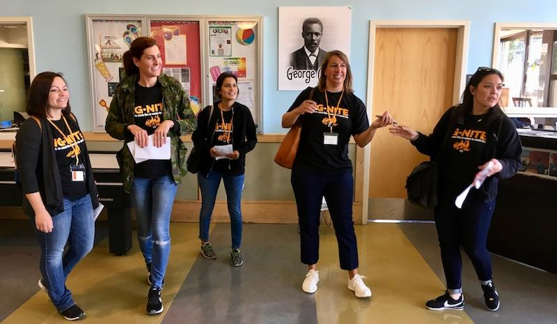 Karina Garcia, center, a new kindergarten teacher at Dr. George Washington Carver Elementary School, checks out the Joseph Lee Rec Center in the Bayview district on a scavenger hunt with fellow SFUSD educators.