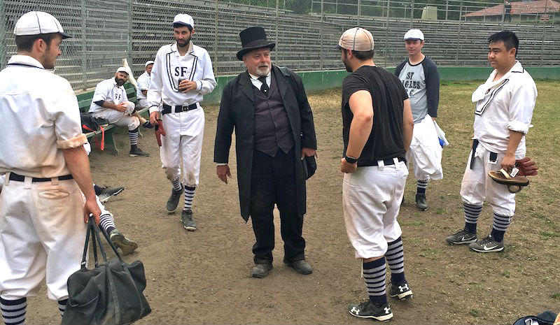 Carl Gibbs, also known as The Sir, greets players after the game.