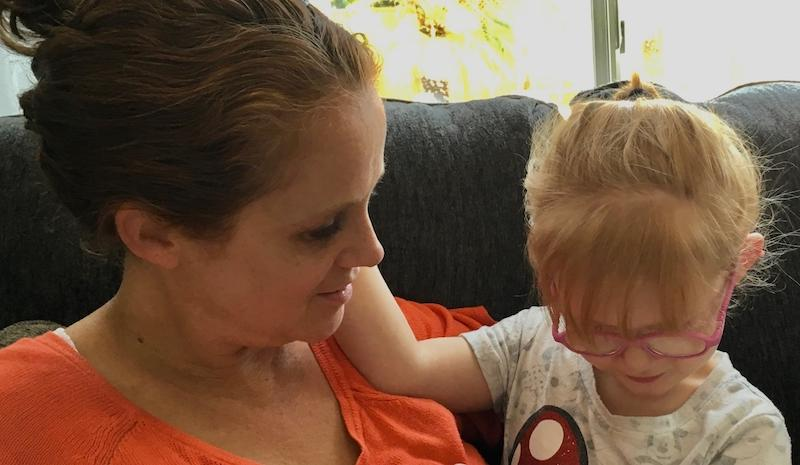 Brooke Adams, 5, who has an intractable form of childhood epilepsy called Dravet Syndrome, enjoys some reading and a quiet moment with her mom, Jana Adams, at their Santa Rosa home in August 2018.