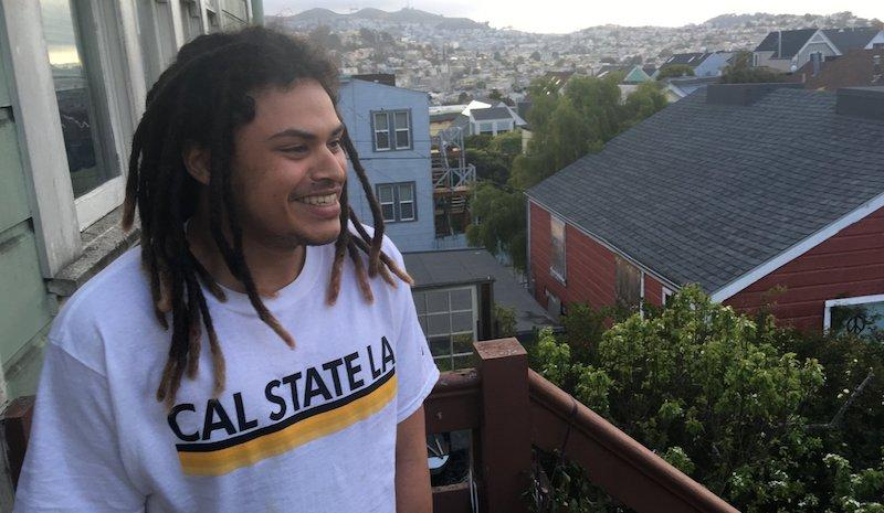 Will Clark on his balcony in his home. He's been living with his resource family, the Huson's, for the past year.