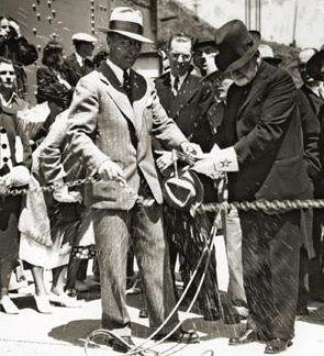 Frank P. Doyle cuts a chain with an acetylene torch at the opening of the Golden Gate Bridge.