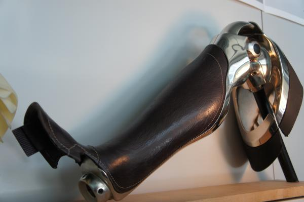 A leather fairing and prosthetic leg on display at 3D Systems-Bespoke.