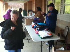 Residents at the Jonesboro Human Development Center receive gifts after Easter Egg Hunt.