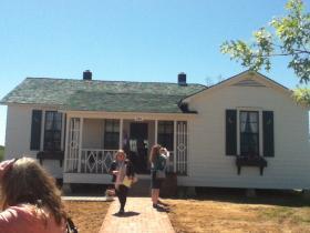 Members of the media leave the Johnny Cash Boyhood Home.
