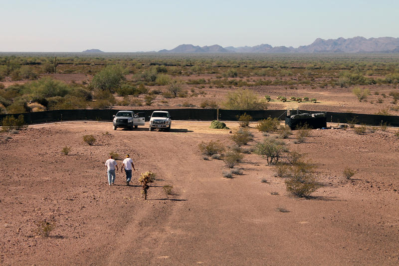Javier Gonzalez and George Onwiler, interns with Arizona Game and Fish, walk back to their truck parked outside the breeding pen at Kofa. The pen is one mile long and a half mile wide.